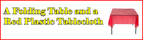 A Folding Table and a Red Plastic Tablecloth by BN Heard (c)